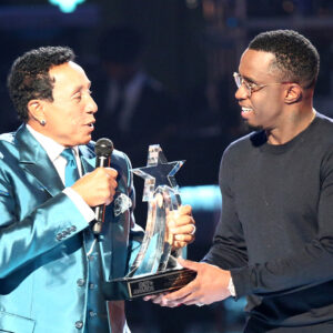 LOS ANGELES, CA - JUNE 28:  Recording artist Smokey Robinson (L) accepts the Lifetime Achievement Award from mogul Sean 'Diddy' Combs onstage during the 2015 BET Awards at the Microsoft Theater on June 28, 2015 in Los Angeles, California.  (Photo by Mark Davis/BET/Getty Images for BET)